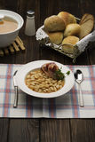 Farmhouse meal. Baked beans with bread rolls Stock Photography