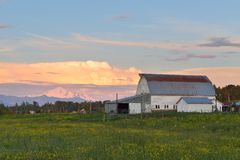 Farmhouse and Mount Baker at sunset Stock Photography