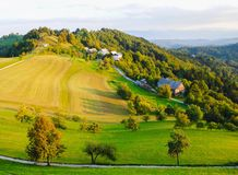 Farmhouse on mountain. In springtime with grass field Royalty Free Stock Image