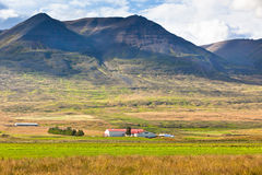 Farmhouse in Mountains of Iceland Stock Photos