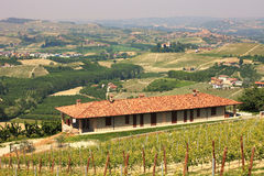 Farmhouse over the hills of Piedmont. Stock Photography