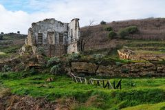 Farmhouse ruin among rural landscape Royalty Free Stock Images