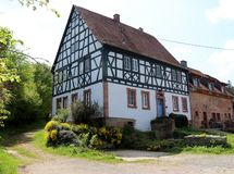 Farmhouse in a small village in Germany with a walking path leading into the forest stock photos