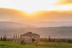 Farmhouse in sunset Stock Photo