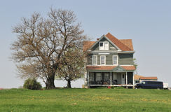 Farmhouse and tree Royalty Free Stock Image