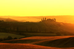 """Farmhouse in Tuscany. The solitaire standing farmhouse """"Casa Belvedere"""" is situated in the Orcia valley – a typical Tuscan landscape Royalty Free Stock Photography"""