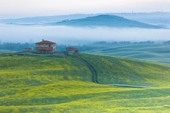 Farmhouse in Tuscany at Sunrise Royalty Free Stock Photography