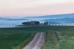 Farmhouse in Tuscany at Sunrise Stock Photo