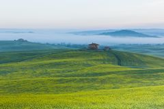 Farmhouse in Tuscany at sunrise Royalty Free Stock Photo