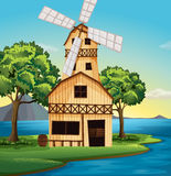 A farmhouse with a windmill Royalty Free Stock Images