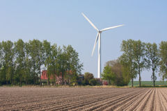 Farmhouse with a windturbine Royalty Free Stock Images