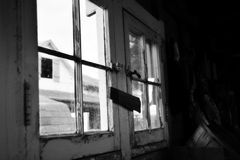 Farmhouse wood window black and white. View from an old farmhouse window in black and white Royalty Free Stock Photo