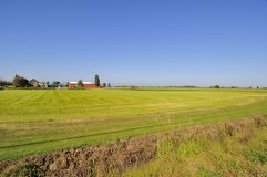 Farmhouses and barns by the fields Stock Image