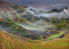 Farmhouses in the highlands of China, farm land, rice terraces. Royalty Free Stock Images