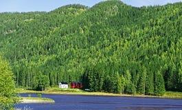 Farmhouses on lake Royalty Free Stock Photos