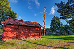 Farmhouses and midsummer pole at Aland Islands, Finland Royalty Free Stock Images