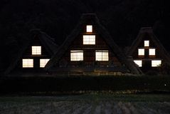 Farmhouses night windows Stock Images