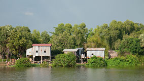 Farmhouses at river bank in Cambodia Stock Images