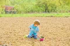 Farming and agriculture. earth day. new life. summer farm. happy child gardener. botanic worker. Spring season. ecology. And environmental protection. small kid stock image
