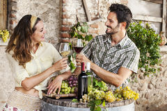 Farming couple drinking wine in their old farm. Farming couple drinking wine in old farm Stock Images