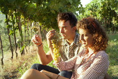 Farming couple relaxing after the grape harvest. Couple relaxing after the grape harvest Stock Images
