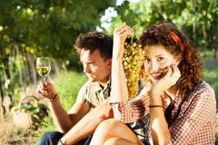 Farming couple relaxing after the grape harvest. And drinking wine Royalty Free Stock Photo