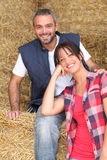 Farming couple sitting on hay Royalty Free Stock Images
