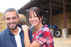 Farming couple. Stood by their farm Royalty Free Stock Photography