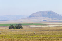 Farming Dam Landscape. Farming fields sprinklers mountains dam waters in rural countryside mountains Stock Photos