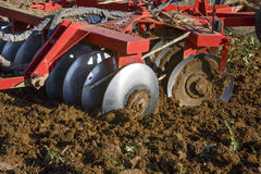 Farming Disks. Farm tractor preparing the soil. Farm tractor preparing the soil and ranking the field before planting, Montijo, Badajoz, Extremadura, Spain stock images
