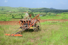 farming equipment and  colored cart Royalty Free Stock Photography