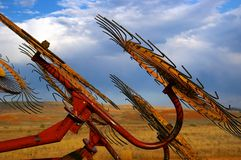 Farming equipment at sunset. Royalty Free Stock Images