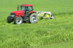 Farming Farm Cutting Grass. Farmer cutting grass in the spring Stock Photography