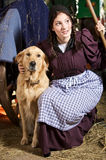Farming girl and her dog Stock Photography