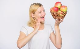 Farming green life. healthy food. Happy woman eating apple. orchard, gardener girl with apple basket. autumn harvest royalty free stock image