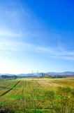 Farming Landscape. Landscape with agriculture parcels under the blue skies, in Italy Royalty Free Stock Photo