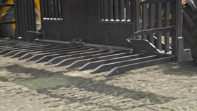 Agricultural machine. Harvesting machine. Farming machinery for hay stacks. Farming loader for transporting bales. Agricultural machinery for loading collected stock footage