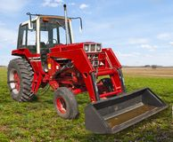 Farming with Old Red Stock Photography