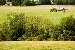 Farming tractor. Spraying pesticide in a field Stock Images
