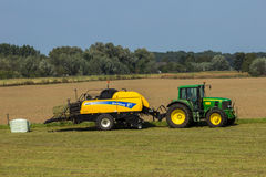Farming tractor and baler Royalty Free Stock Photography