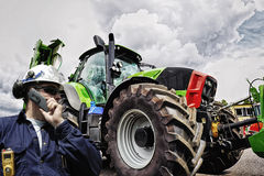 Farming tractor and mechanic Stock Photography
