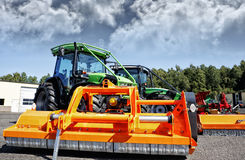 Farming tractor and mower Royalty Free Stock Images