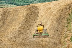 Farming with tractor and plow in field Royalty Free Stock Photography