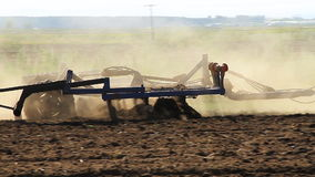 Farming. The Tractor Plows the Land. The Tractor Plows the Land. Farmer using modern farm tractor with disk harrows for harrowing field stock footage