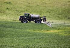 Farming tractor  spraying Stock Photo
