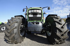 Farming tractor and tires. Farming tractor with large tires, frontal view, all trademarks removed Royalty Free Stock Photography