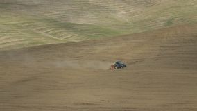Farming with a tractor in Tuscany stock video footage