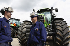 Farming tractors with two mechanics Stock Images