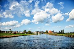 Farming village view from the water. Small houses Royalty Free Stock Photography