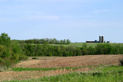 Farmland. SE rural Iowa landscape with a farm in the background royalty free stock photo